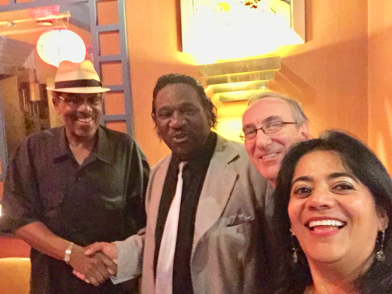 Professor Harp and Mud Morganfield (essentially, Muddy Waters, Jr., Muddy's eldest son) with Alex and Lilian Dina.